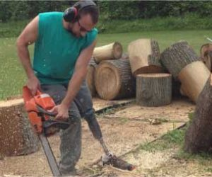 Man With Prosthetic Leg Using Power Saw