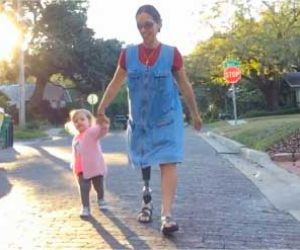Woman With Prosthetic Leg Walking With Young Child