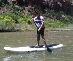 Man Paddleboarding With Prosthetic Leg